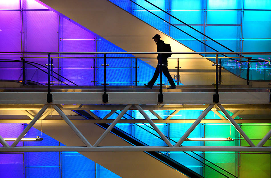 A single students walks past the glowing wall display in the Aldred Centre at SAIT Polytechnic in Calgary on Wednesday, Feb. 11, 2015. The Aldred Centre is the largest building complex on campus. (Photo by Carys Richards/The Press)