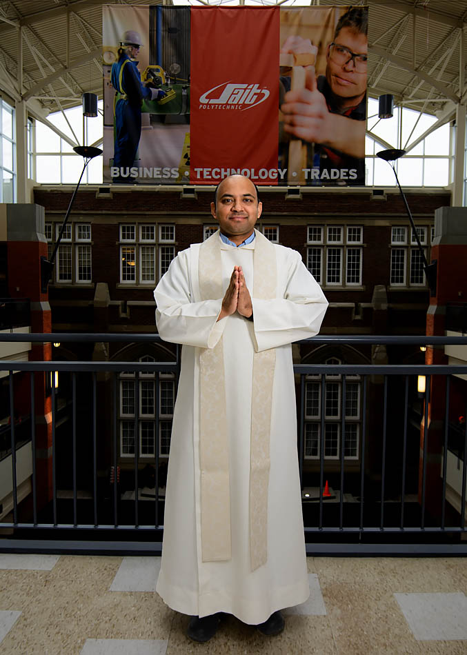 Catholic priest Father Sajo Jacob poses for a portrait in the Irene Lewis Atrium in the Stan Grad Centre on SAIT campus in Calgary on Wednesday, Feb. 11, 2015. Father Sajo says mass every Wednesday at 11:45 p.m. in the interfaith centre. (Photo by Yasmin Mayne/The Press)