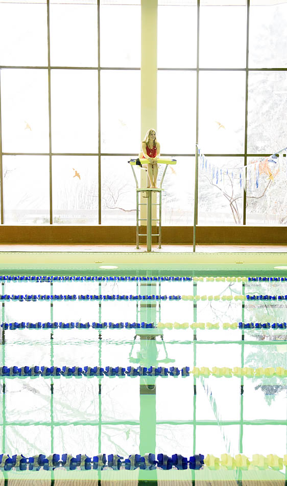 Lifeguard Kerrin Collie watches over an empty pool moments before closing the facility in the SAIT Campus Centre in Calgary on Wednesday, Feb. 11, 2015. Besides being a lifeguard, Collie is also a second-year travel and tourism student at SAIT Polytechnic.(Photo by Carys Richards/The Press)