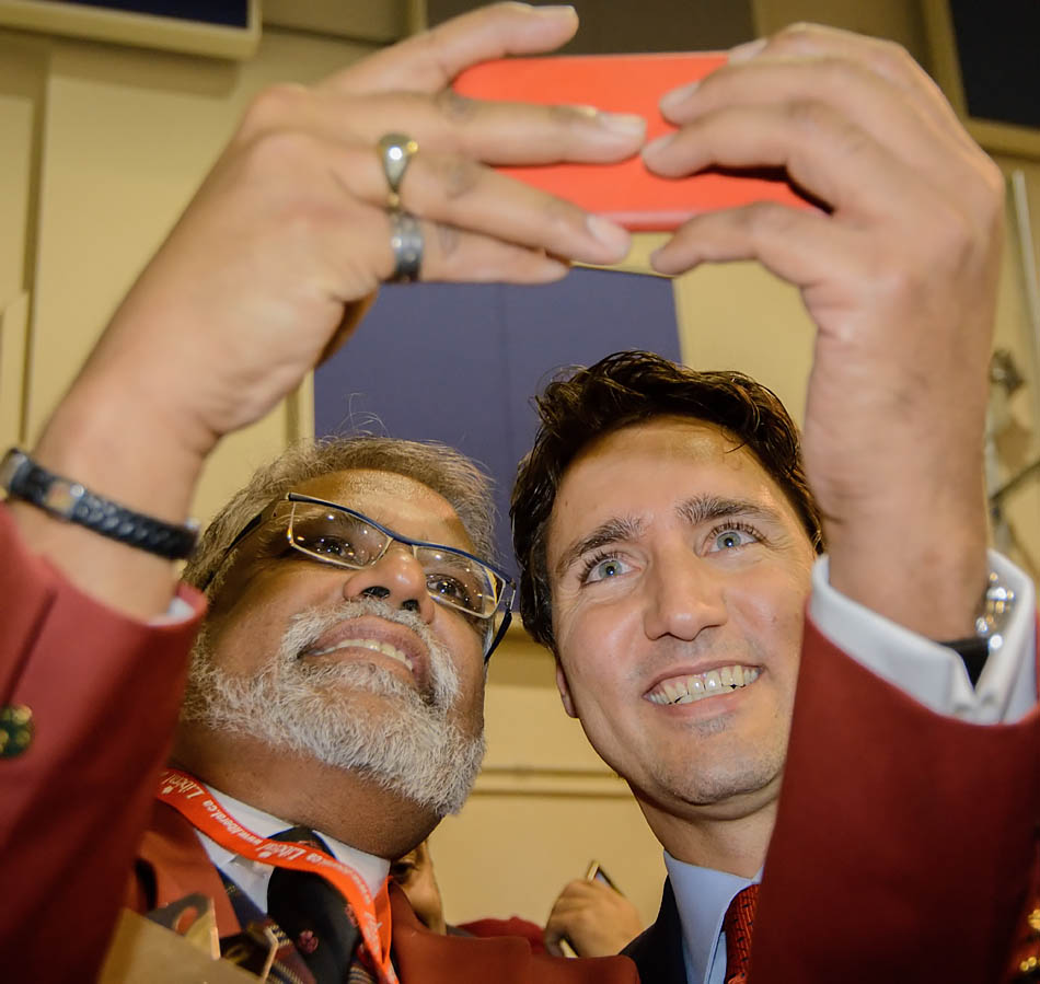 Liberal party supporter and volunteer Gerard Sinanan takes a selfie with Justin Trudeau after Trudeau's speech at the Kirby Centre in Calgary on Thursday, Feb. 5, 2015. Trudeau came to Calgary to gather support for local candidates as well as for the Liberal party in general, as this year is an election year for Canada. (Photo by Yasmin Mayne/The Press)