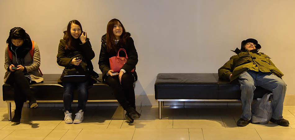 By mid-afternoon on a Monday, some Calgarians are so tired that they will sleep anywhere, including the public benches in TD Square mall in Calgary on Monday, Nov. 24, 2014. Such relaxation can be amusing to some. (Photo by Yasmin Mayne/The Press)