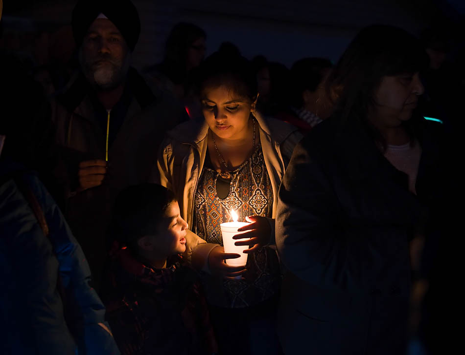 Danza Ali, right, and Rahim Aminzada show their support at the Glow in the Dark rally in Calgary on Friday, Nov. 21, 2014. Community residents organized the support rally, which drew a crowd of approximately 300 people, for a 17 year-old girl who was sexually assaulted at the bus stop on Nov 14, 2014. (Photo by Carys Richards/The Press)