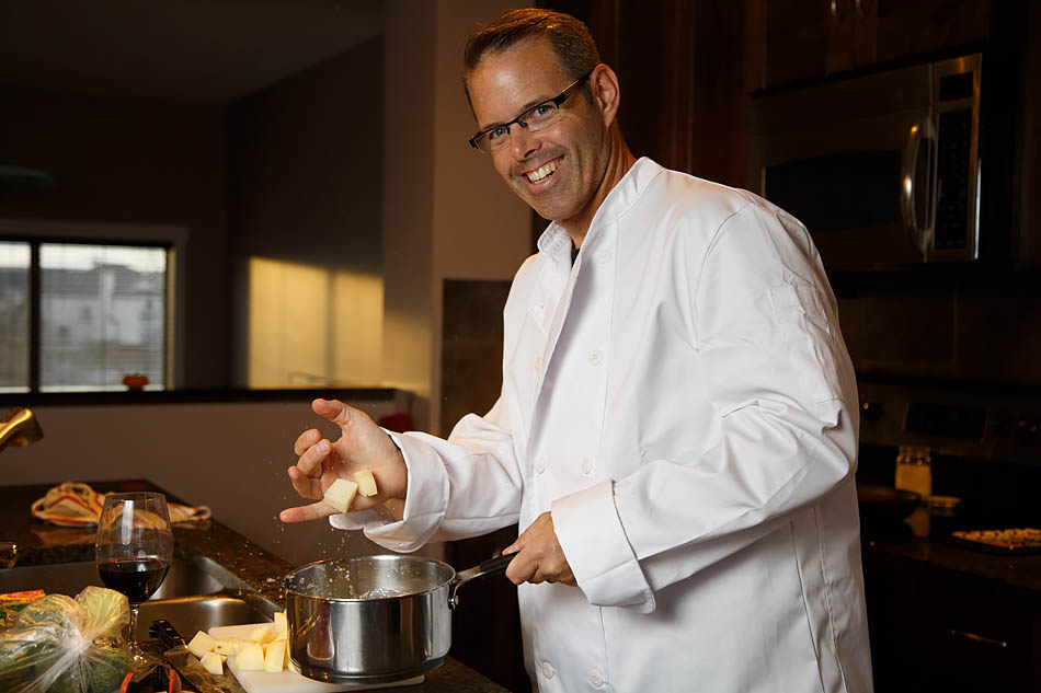 "Andrew Maclachlan a husband and father of two preparing dinner in Calgary on Thursday, Oct. 30, 2014. As a commercial realtor he spends a lot of time in his home office, his favourite hobby is to cook. ""Even cooking the most common meals is fun"" (Photo by Megan Bjornson/SAIT Polytechnic)"
