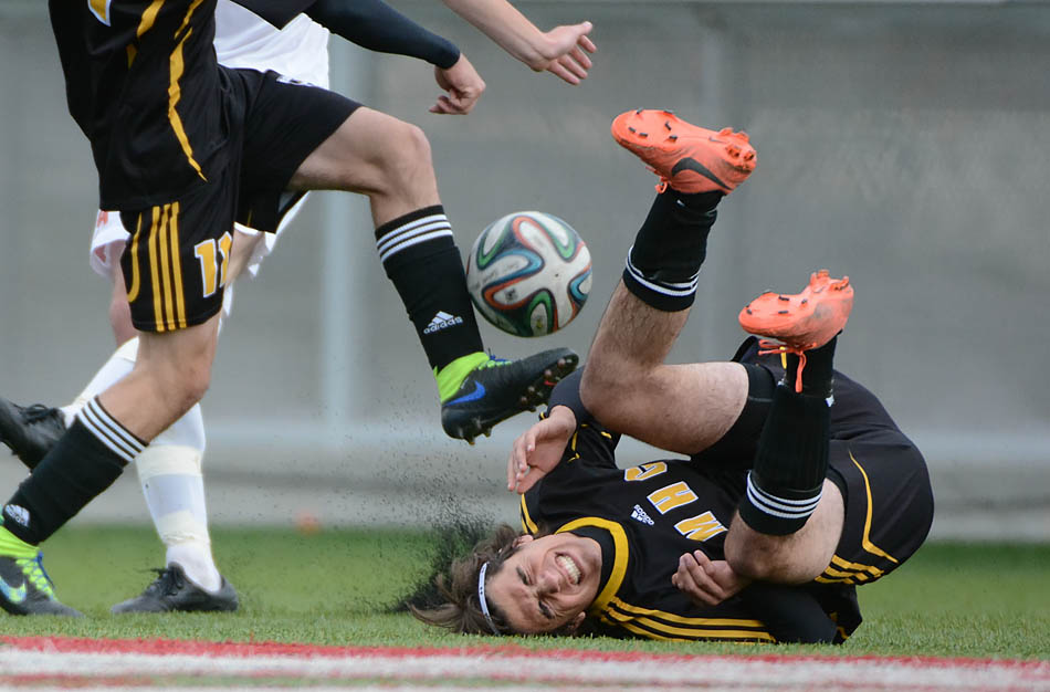 Rattler, Bruno Reinosa, takes a fall during the last season game at the Cohos Commons Field in Calgary on Sunday, Oct. 19, 2014. SAIT Trojans tied the Medicine Hat Rattlers in the last season game, but will not be going to the playoffs. (Photo by Yasmin Mayne/The Press)