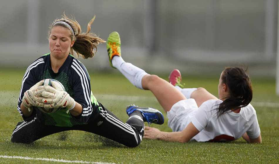 Trojan's women's soccer team lost 4-0 to Medicine Hat in Calgary on Sunday, Oct. 19, 2014. Medicine Hat's goalie Julie Devine 'left' dives just in time to save it from Michelle MacKinnon (Photo by Liam Alexander Glass/The Press)