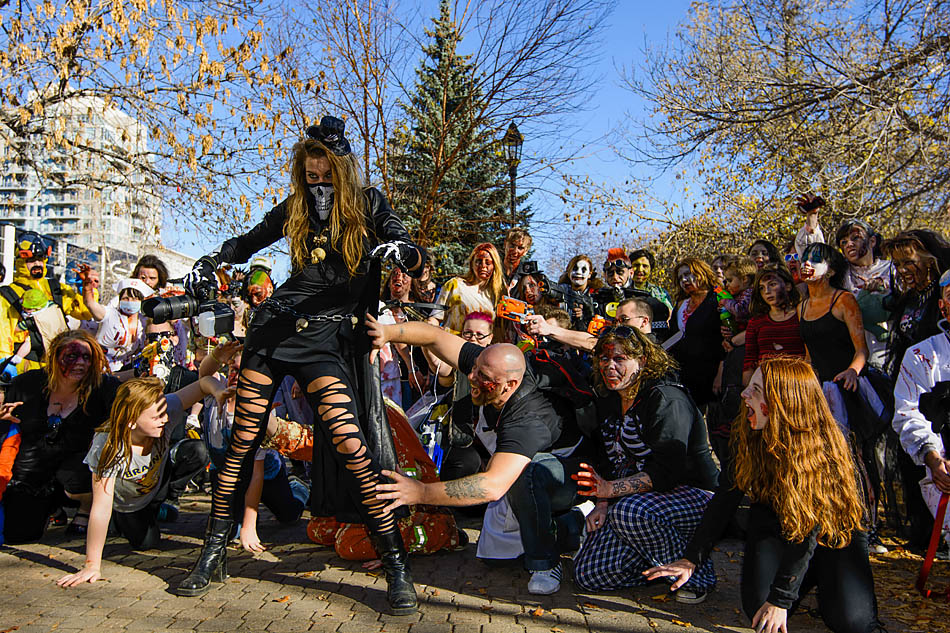 Zombies attack their fearless leader at the Zombie Walk in Calgary on Saturday, Oct. 18, 2014. Zombie Walk is a non-profit event where regular Calgarians dress up as zombies and walk around downtown. (Photo by Yasmin Mayne/The Press)