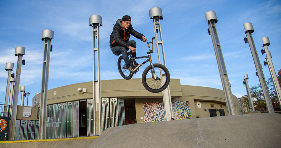 "BMX Biker: Dominik Falle attempts the trick ""toboggan"" at Shaw Millennium Skatepark in downtown Calgary. Falle has been BMX biking for three years. (Photo by Brooke Hovey/The Press)"