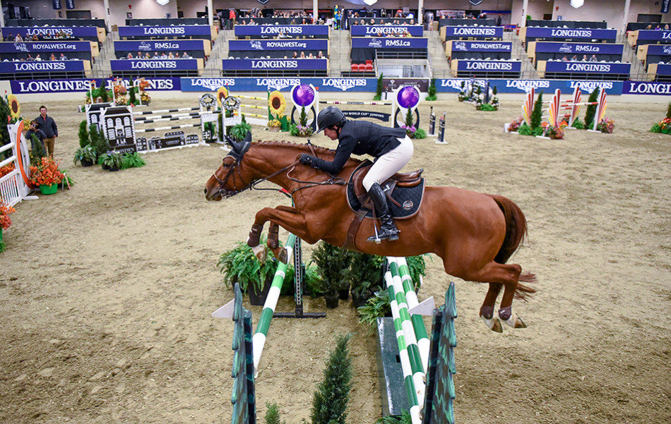 Horse Jumper: Nicole Gergely and Vianda navigate the first jump at the Longines FEI World Cup Jumping event at the Agrium Centre in Calgary. (Photo by Tyler Marr/The Press)