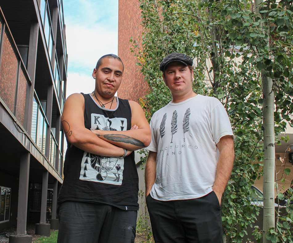 Filmakers: Caleb Behn, left, and Damien Gillis pose for a photo outside of their hotel. The two were in Calgary where their documentary, Fractured Land, was showcased during the Calgary International Film Festival. (Photo by Stephanie Joe /The Press)