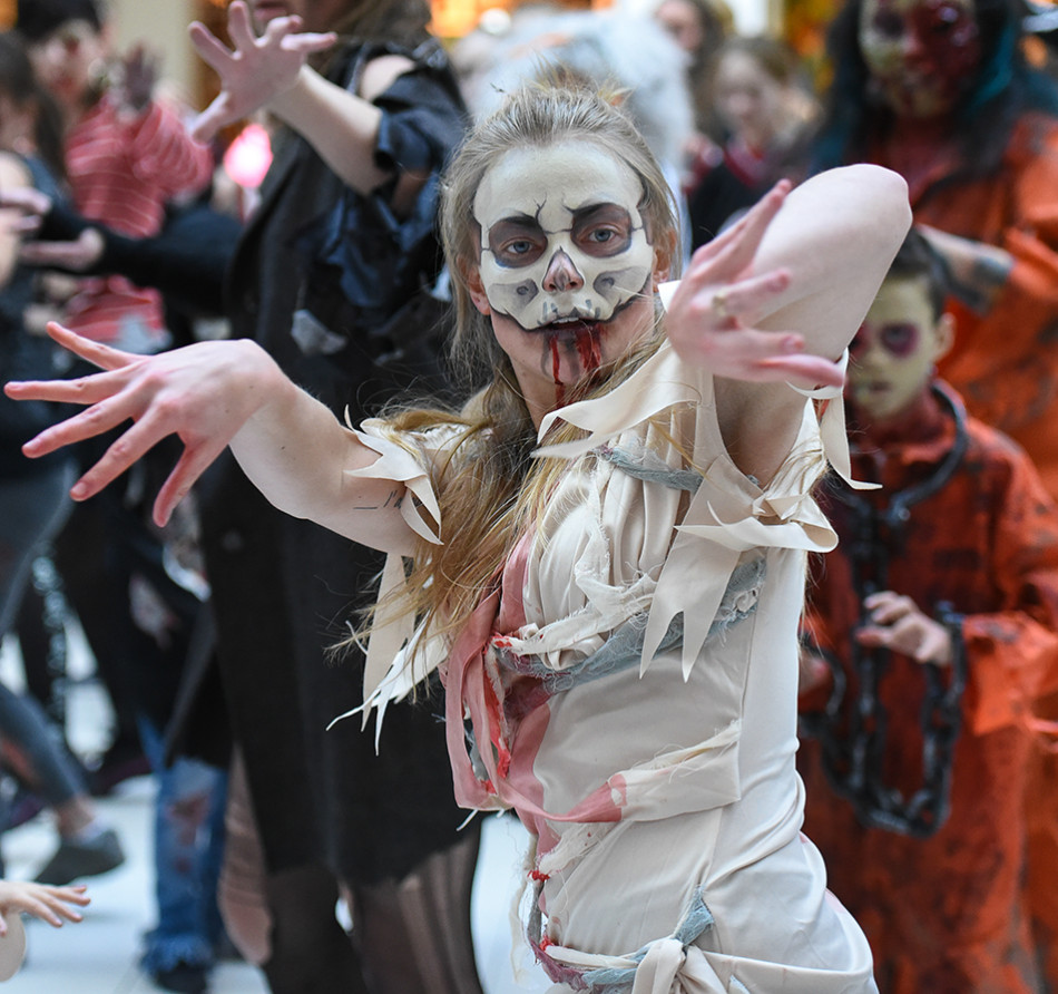 Zombie Dance: Calgarians dressed in their scariest zombie costumes dance to the beat of the Michael Jackson tune Thriller during a dance mob at Southcentre. The event was part of a global effort to reach a new world record. (Photo by Kenneth Appleby/The Press)