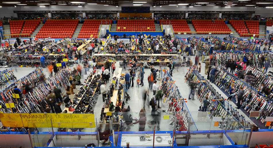 Lotsa Skis: Shoppers look over the huge selection of ski and snowboarding equipment at the Calgary New & Used Ski Sale at Max Bell Centre. Patrons waited as long as a half-hour just to get into the sale. (Photo by Ryan Wellicome/The Press)