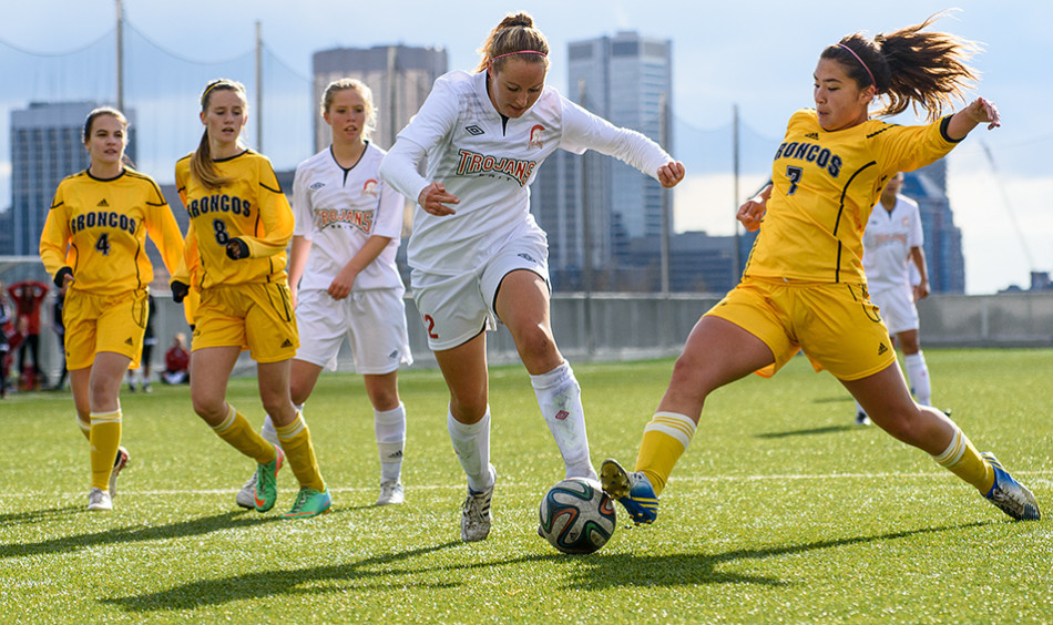 Soccer Battle: SAIT Trojans Kaitlyn Silcox, 12, fights for the ball during ACAC Women's Soccer action against the Olds Broncos at SAIT's Cohos Commons soccer field. (Photo by Vanessa Paterson/The Press)