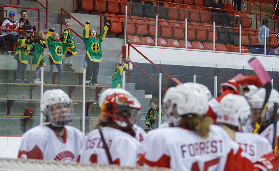 Biggest Fans: Kids from the Okotoks Oilers minor hockey team cheer for the SAIT Trojans as they take on the Olds Broncos during ACAC women's hockey action at the SAIT arena. The Trojans defeated the Broncos by a score of 5-0. (Photo by Joshua Neumann/The Press)
