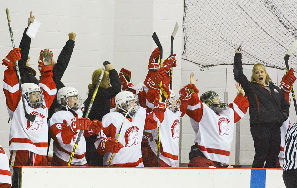 Celebration: The SAIT Trojans bench celebrates the Trojans' first goal of the 2015/16 season against the NAIT Ooks at SAIT Arena. The Trojans won the game by a score of 2-0. (Photo by Ryan Wellicome/The Press)