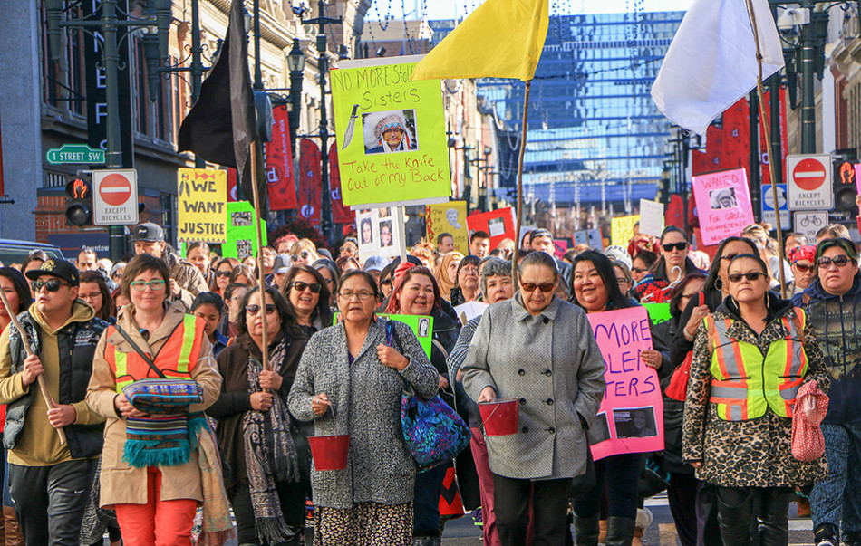 Vigil: People came together to participate in the 11th Annual Spirit in Vigil held at City Hall. The vigil was headed by the Awo Taan Healing Lodge Society, the only Aboriginal women's shelter in Canada. (Photo by {Tracy Tapang/The Press)