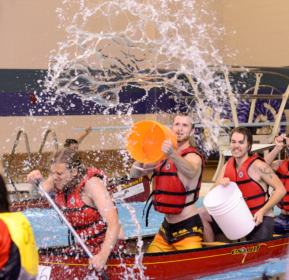 Water Battle: Ryan Long, centre, and his team the Fixed Wing Pirates, attempt to sink competitors during the H20 Battleship championship at the Aquatic Centre in SAIT's Campus Centre. (Photo by Andy Maxwell Mawji/The Press)