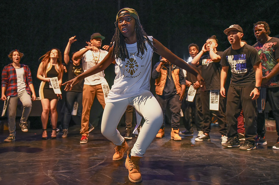 Krump Dance: Nyalah, an international student from Zimbabwe, krumps while her dance troupe, Empirical Freedom, cheers her on during a krumping showcase at Arts Commons. (Photo by Elizabeth Cameron/The Press)