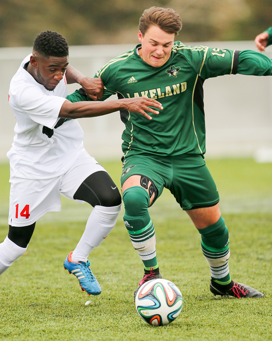 Field Battle: SAIT Trojan's player Tariq bin Zayyad, left, battles with Lakeland College Marc Maldiney during ACAC men's soccer action at Cohos Common Field on SAIT campus. The Trojan's defeated Lakeland College 4-2. (Photo by Kyle Meller/The Press)