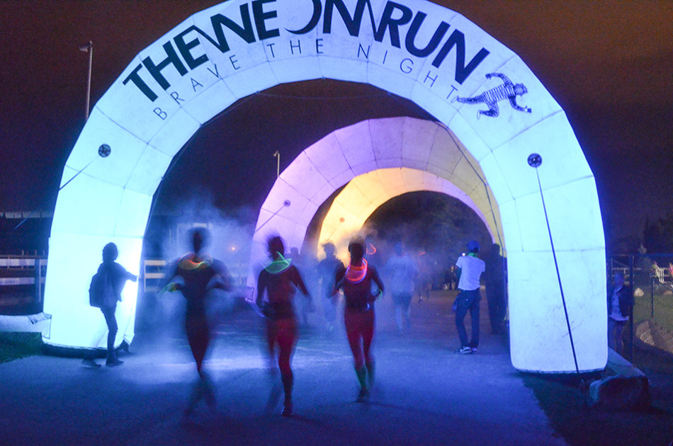 Neon Run: Calgarians participate in the Neon run in Calgary on Saturday, Sept. 19, 2015. The Neon Run is a 5K event which features a number of lighting displays throughout. (Photo by Shayla Deeton/The Press)