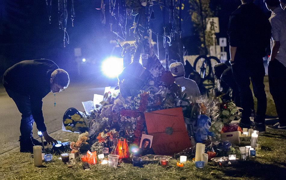 Paying Respects: A group of high school students gather at a memorial in the community of Erin Woods Friday, Sept. 25, 2015. The memorial was set up near the scene of a fatal accident which killed 16-year-old Nickolas Paswisty, a resident of the community. (Photo by Andy Maxwell Mawji/The Press)