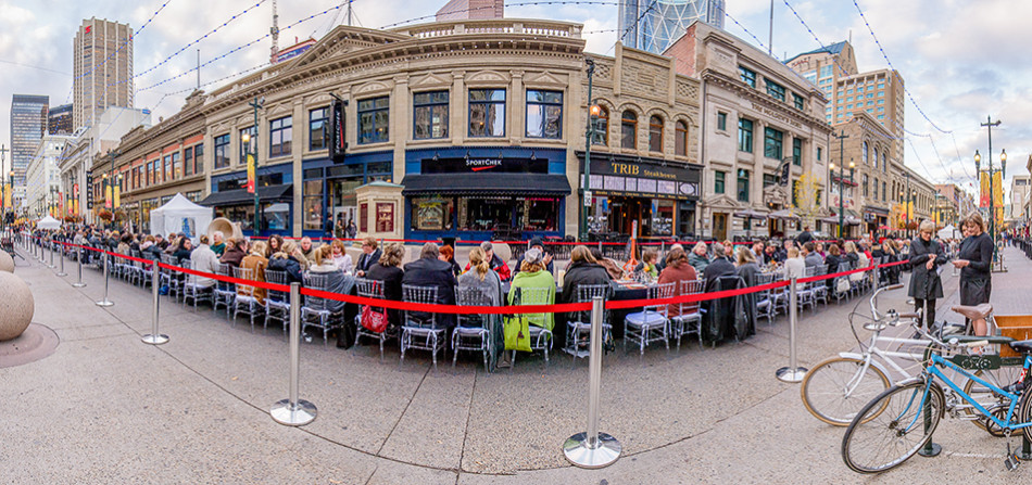 Long Table: Food enthusiasts take in the 3rd Annual Really, Really Long Table Dinner hosted by City Palate along Stephen Avenue in downtown Calgary Monday, Sept. 21, 2015. The $200-a-plate dinner features culinary delights from several of Calgary's finest food vendors including Blink, Catch & The Oyster Bar, Charcut Roast House, Divino, Teatro, Wine-Ohs, Trib Steakhouse, Home Tasting Room and The Bank & Baron. Wine pairings were provided by The Cellar. This photo is actually a composite of many pictures digitally stitched together as a type of panorama image. (Photo Illustration by Andy Maxwell Mawji/The Press)