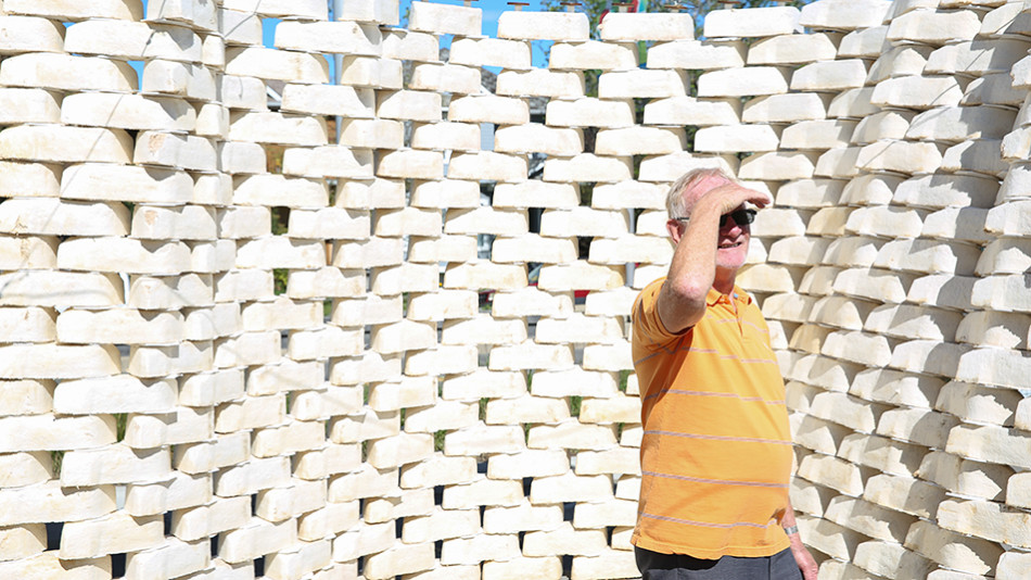 Beakerhead Fun: Ralph explores the fungi fortress at a Beakerhead event on Memorial Dr NW in Calgary on Sunday, Sept. 20, 2015. The bricks are created using a mix of sawdust and mushroom spores. Beakerhead is a yearly arts and culture event featuring several displays and exhibitions that further the understanding of science and engineering in a fun and interactive way. (Photo by Liam Quinn/The Press)