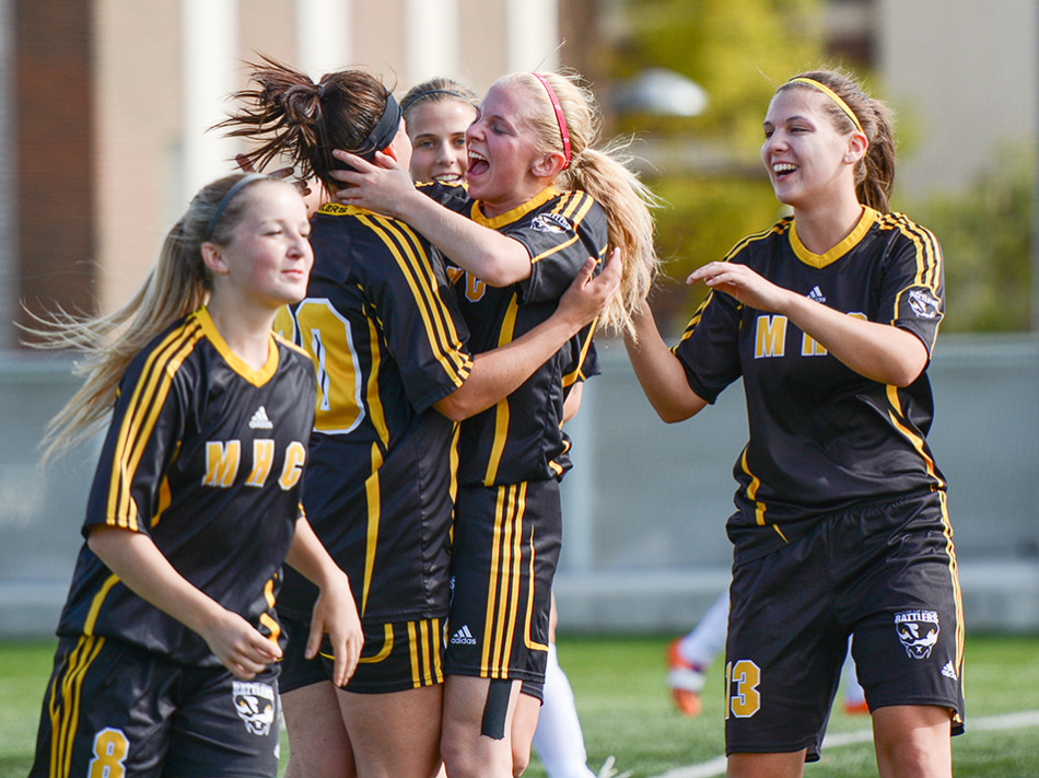 Celebration: Members of the Medicine Hat Rattlers women's soccer team celebrate after scoring the first goal of the game against the SAIT Trojans during regular season play at Cohos Commons Field in Calgary on Saturday, Sept. 19, 2015. The Rattlers went on to take the game in a 4-1 victory. (Photo by Ryan Wellicome/The Press)