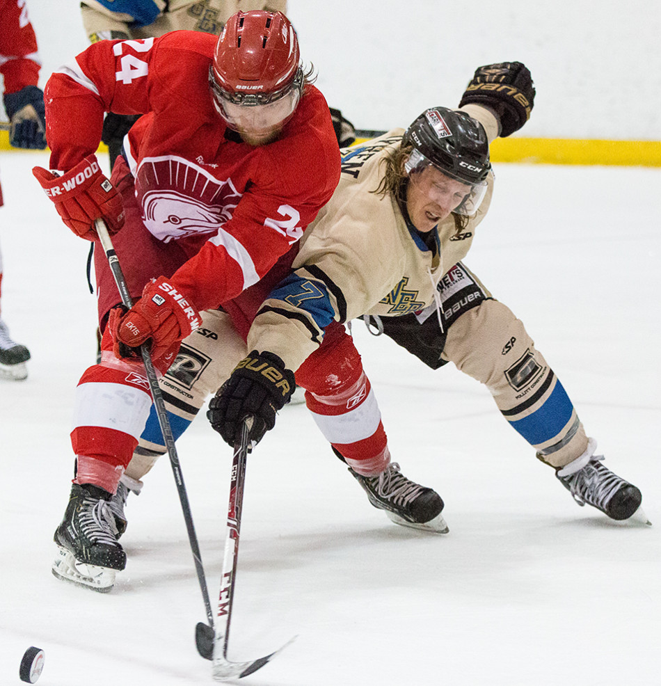 Puck Battle: SAIT Trojan's Eric Walker, left, battles a Bentley Generals player for the loose puck during pre-season hockey action at the SAIT Campus Centre in Calgary on Saturday, Sept. 19, 2015. (Photo by Kyle Meller/The Press)