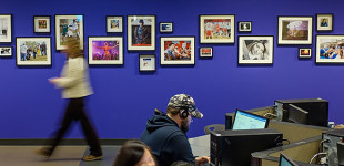 A gallery of photographs adorns the walls of the Reg Erhardt Library at SAIT in Calgary on Thursday, April 7, 2016. The temporary exhibition features the work of the journalism program's second-year photo major students. (Photo by Rob Galbraith/SAIT)