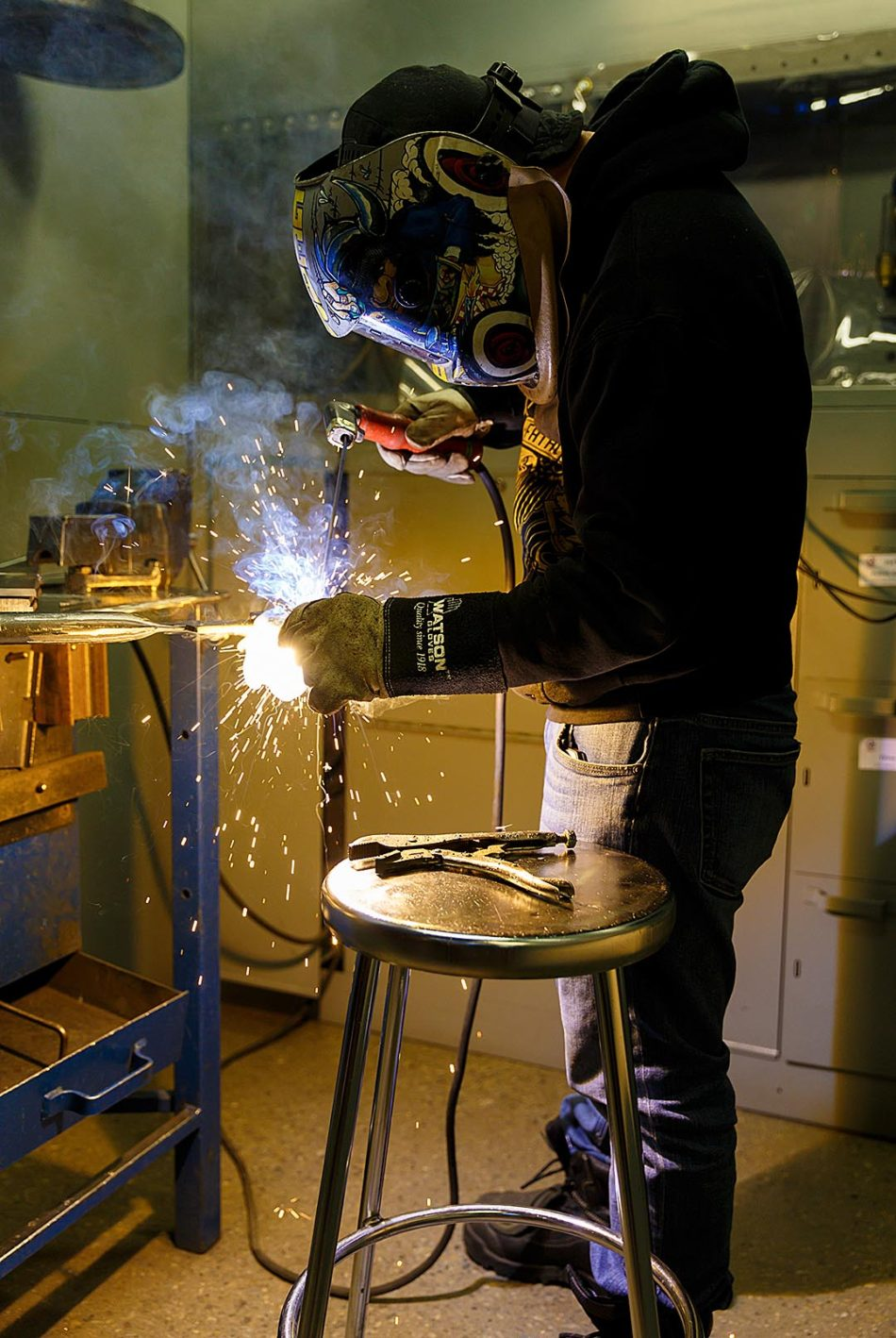 Sparks Fly: Efren Flores works on a welding project during class in the Aldred Centre at SAIT in Calgary on Thursday, Feb. 16, 2017. Flores is a first year student with a graduation date set for June 2018. Welding is a 24 week program at SAIT that allows students to get hands on experience with joining and severing metals, as well as learning about the various processes and tools used in the welding industry. (Photo by Dawn Gibson/The Press)