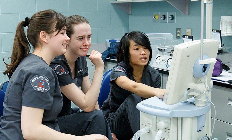 A Calculated Breath: Rachel Burick, left, with sister, Olivia Burick participate with Mylinh Hong in a respiratory therapy lab in Calgary on Thursday, Feb. 16, 2017. SAIT's respiratory therapy program lasts for three years and prepares students for a career in hospital emergency rooms and intensive care units. (Photo by Parker Crook/The Press)