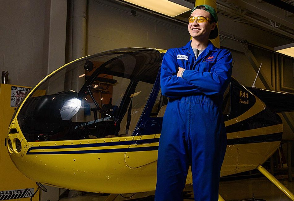 Head in the Clouds: Second-year aircraft maintenance engineers technology student Garrett Lee stands for a portrait during a break in his HELI 320 - helicopter maintenance practices class at the Art Smith Aero Centre in Calgary on Thursday, Feb. 16, 2017. The centre is one of three training facilities within SAIT's School of Transportation, along with the Buck Crump Centre for rail training and technology and the Clayton Carroll Automotive Centre. (Photo by Kayla Van Den Bussche/The Press)