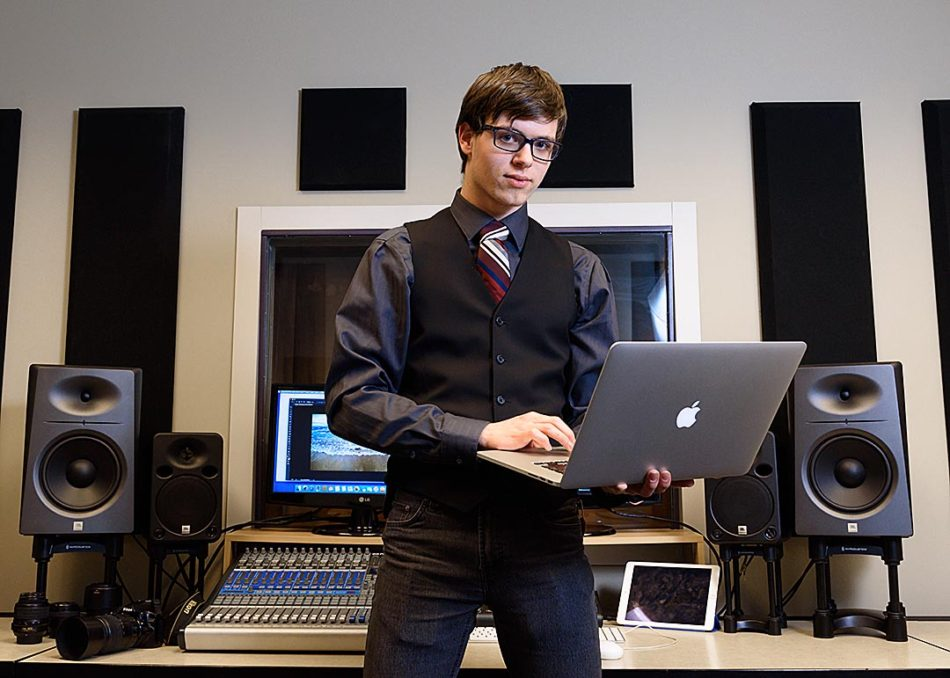I've got the power: First year new media production and design student, Josh Boak, poses for a portrait in the sound proof editing room at SAIT in Calgary on Thursday, Feb. 16, 2017. Boak is in the sound booth/editing suite for the new media production and design students, a place they can sign out to do their work and he uses often. The program Boak is taking teaches them the tools to being graphic designers, photographers and filmmakers, which he states as perfect for him. (Photo by Kelsey Zeoli/The Press)