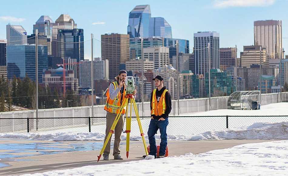 First year SAIT Geomatic Engineering students, Tyson Maton, left, and Bryson Muir, practice their surveying skills on campus, in Calgary on Thursday, Feb. 16, 2017. (Photo by Carole Chabot/The Press)