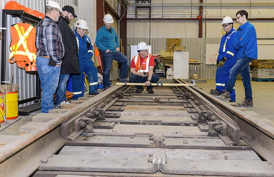 Laying down the line: Tom Gough, centre, training specialist for the railway division, instructs a track inspection level 2 class as part of a corporate rail compliance training class at the N.R. Buck Crump building at SAIT's Mayland Heights campus in Calgary on Thursday, Feb. 16, 2017. Gough, a retired training specialist with Canadian Pacific Railway, was teaching railway track inspection, including switches, frogs, guard rails, and derails, during the one-day certification course. The certification needs to be updated every three years. (Photo by Ashley Orzel/The Press)